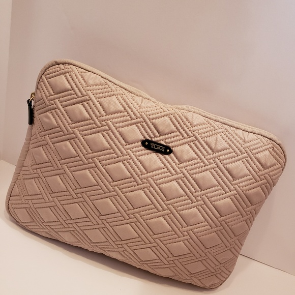 Tumi Handbags - Tumi tan quilted computer case